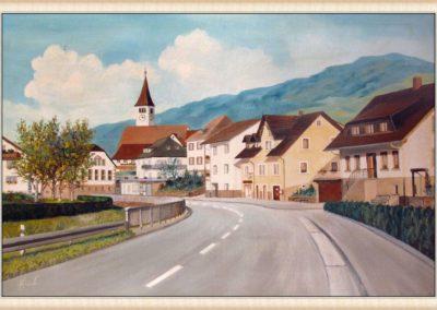 Hans Busch malt auch immer wieder für Privatleute Bilder von ihrem Zuhause oder wie hier auch ganze Straßenzüge (Hauptstraße 7 bis 12). Dieses Bild schuf er 1985 gleich zweimal. Ein Exemplar hängt heute noch in einem Privathaus in der Hauptstraße, das andere war für die aus Dörlinbach stammende Schönstätter Marienschwester M. Fiatis Schätzle (1923 bis 1993) im argentinischen San Isidro bestimmt.